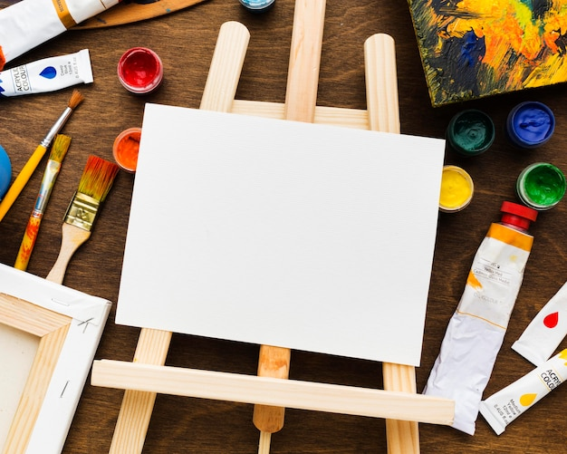 Easel and copy space white canvas Free Photo
