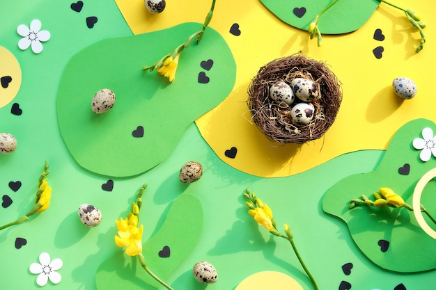 Easter background in green and yellow with eggs Premium Photo