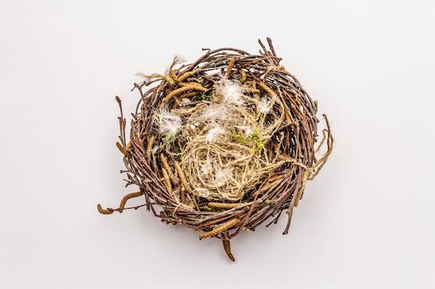 Easter bird nest isolated on white background. zero waste, diy concept Premium Photo