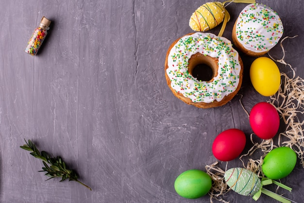 Easter cake and colorful eggs on a dark background Premium Photo
