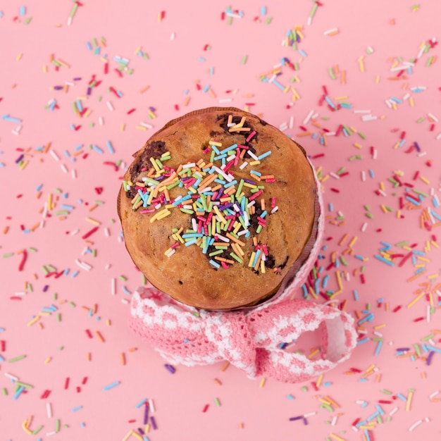 Easter cake with bright sprinkles on table Free Photo