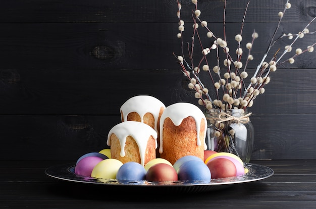Easter cakes and eggs on a dark, rustic, wooden background Premium Photo