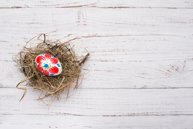 Easter egg over nest on wooden background Free Photo