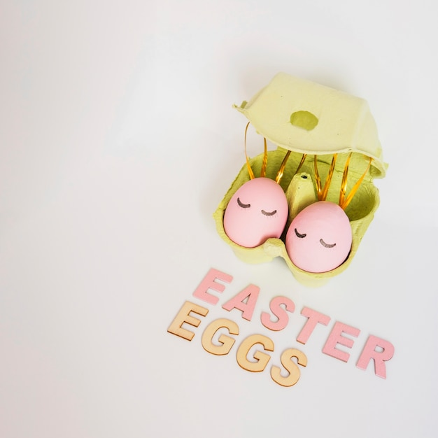 Easter eggs in green rack Free Photo