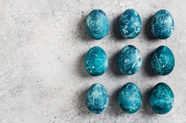 Easter eggs row painted by hand in blue Free Photo