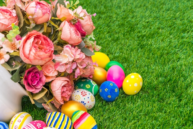 easter eggs with artificial flower on fresh green grass