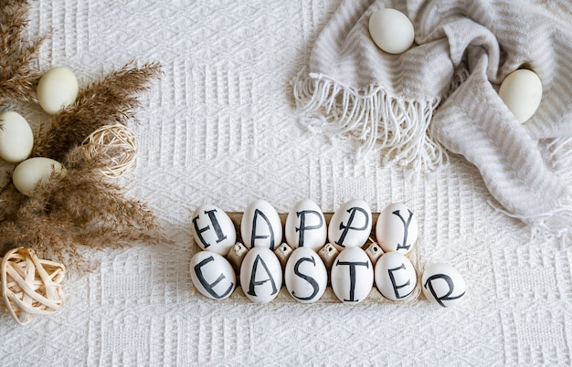Easter eggs with the inscription happy easter, holiday decor . still life with an easter cozy mood. Free Photo