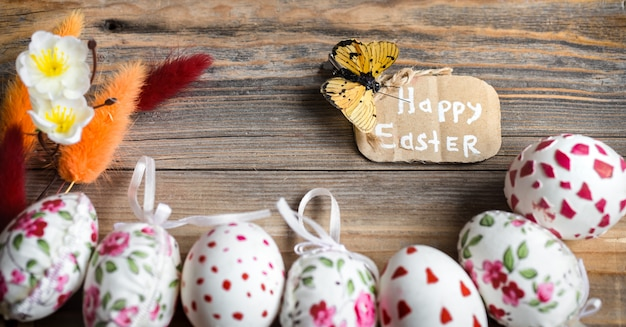 Easter eggs on a wooden background Premium Photo