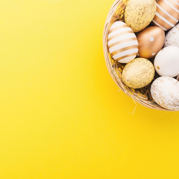 Easter flat lay of eggs in nest Free Photo