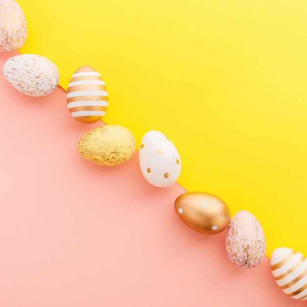 Easter flat lay of eggs on turquoise Free Photo