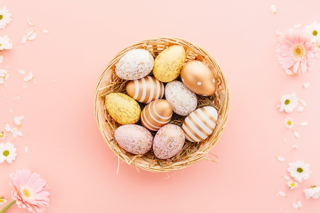 Easter flat lay of eggs with flowers on pink Free Photo