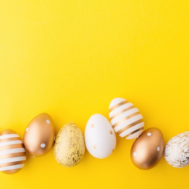 Easter flat lay of eggs on yellow Free Photo
