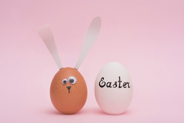 Easter inscription on white egg with bunny Free Photo