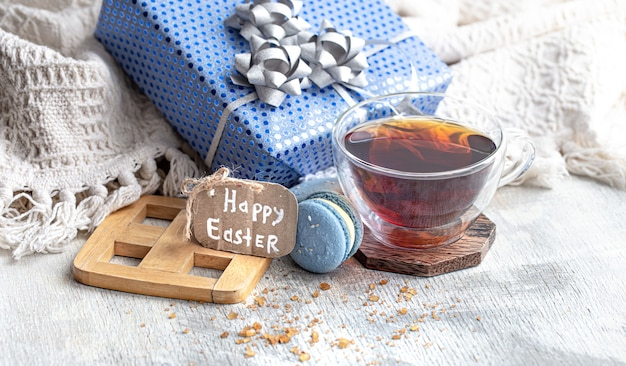 Easter mood, cozy easter still life with decor by the window . morning tea with dessert . the concept of the easter holidays . Free Photo