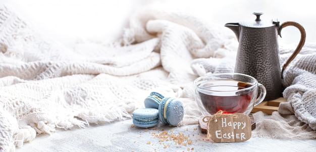 Easter mood, cozy easter still life with decor by the window. morning tea with dessert. Free Photo