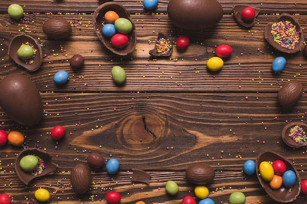 Easter sweets on wooden background Free Photo