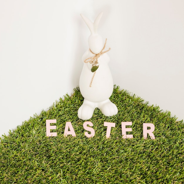 Easter word and hare figurine Free Photo