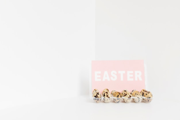 Easter word and quail eggs Free Photo