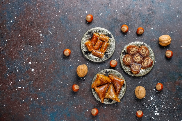 Eastern sweets,assorted traditional turkish delight with nuts. Free Photo