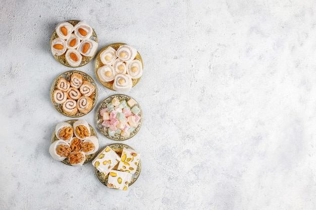 Eastern sweets.turkish delight,lokum with nuts,top view. Free Photo