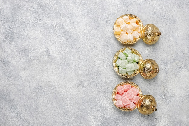 Eastern sweets.turkish delight, lokum with nuts, top view. Free Photo