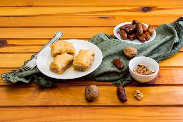 Eastern sweets with dates fruit and walnuts Free Photo