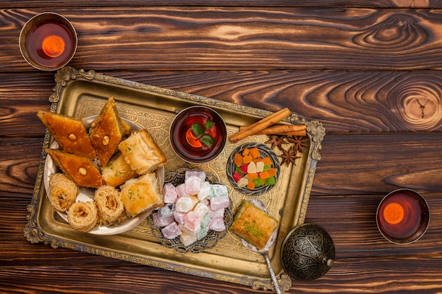 Eastern sweets with tea on table Free Photo