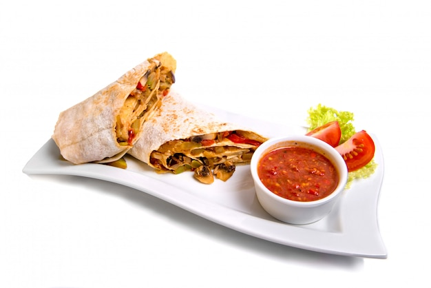 Eastern traditional shawarma plate with sauce isolated on white. Premium Photo