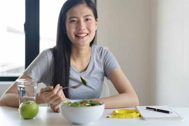 Eat healthy food on wellness lifestyle. woman eating salad. Premium Photo