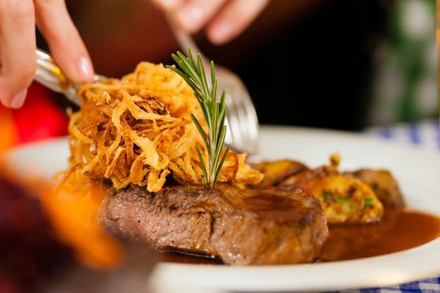 Eating in bavarian restaurant or pub Premium Photo