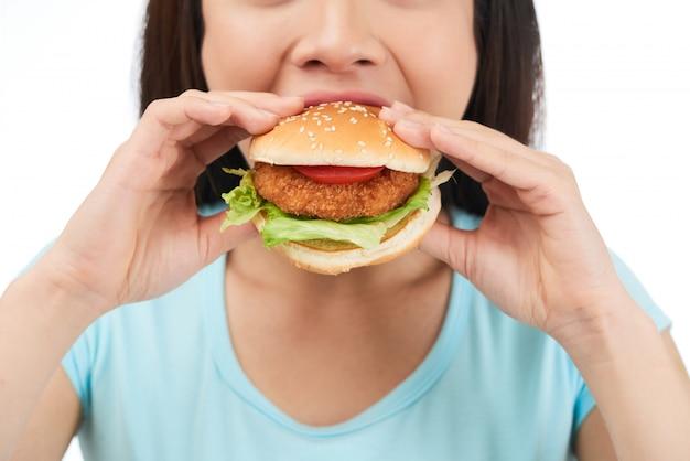 Eating delicious hamburger Free Photo
