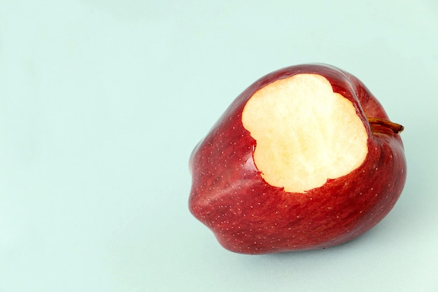 Eating a red apple fruit,  it's yummy for diet healthy Premium Photo