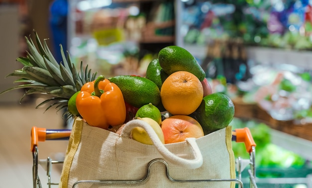 Eco bag with different fruits and vegetables. shopping in the supermarket. Free Photo