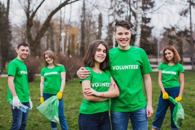 Eco concept with group of volunteers Free Photo
