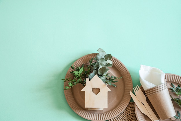 Eco-friendly disposable utensils made of bamboo wood and paper on a trending background. Free Photo