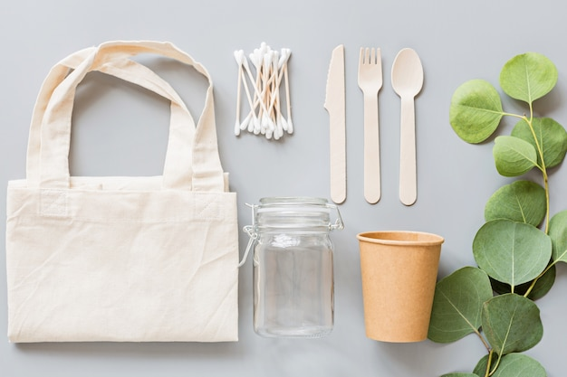 Eco natural products flat lay on gray background. sustainable lifestyle concept. zero waste, plastic free items. stop plastic pollution. Premium Photo
