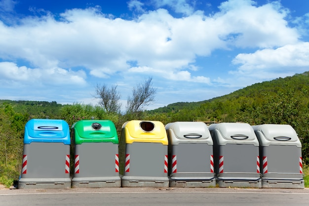 Ecologic selective trash containers by colors Premium Photo
