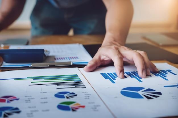 Economist analysing stock marketing chart document  buy order in market stock. Premium Photo
