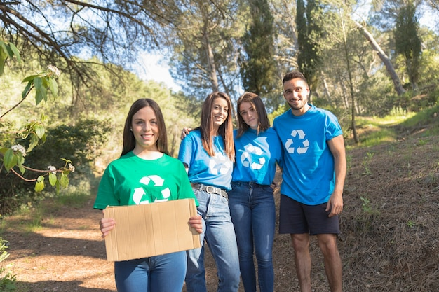Ecycle activists standing in forest Free Photo