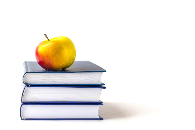Education or back to school . an appleon a stack of books isolated on a white  with copyspace. Premium Photo