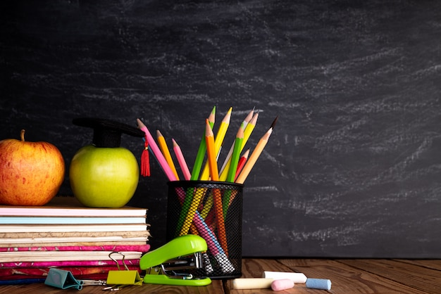 Education or back to school  on chalkboard background. Premium Photo