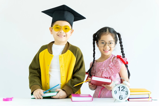 Education and back to school concept  portrait of happy kids with book o Premium Photo