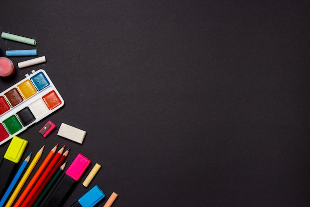 Education and back to school concept. school supplies for drawing on a black background. top view, flat lay. Premium Photo