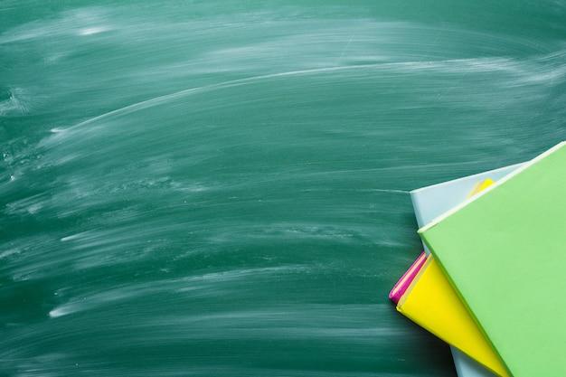Education background on green chalkboard Premium Photo