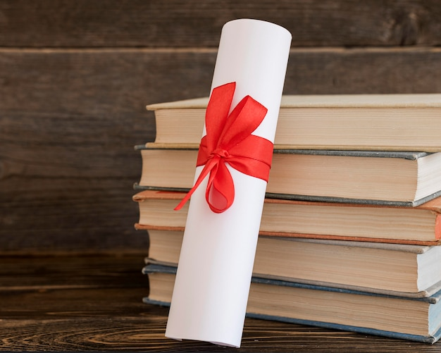 Education diploma certificate and books Free Photo