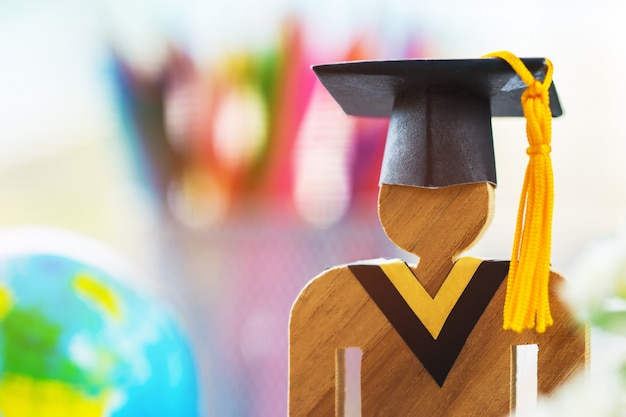 Education knowledge learning study abroad international ideas. people sign wood with graduation Premium Photo