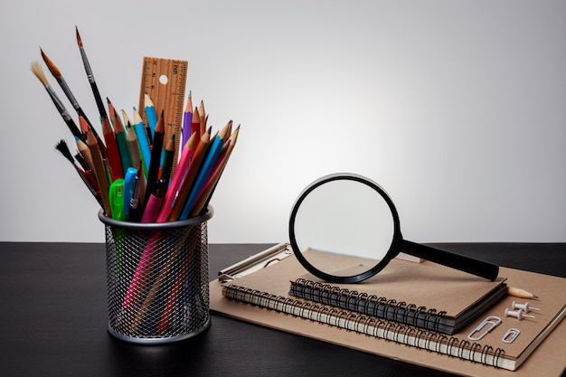 Education objects on black table in dark tone image Premium Photo