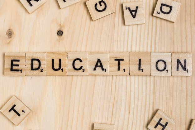 Education word on wooden tiles Free Photo