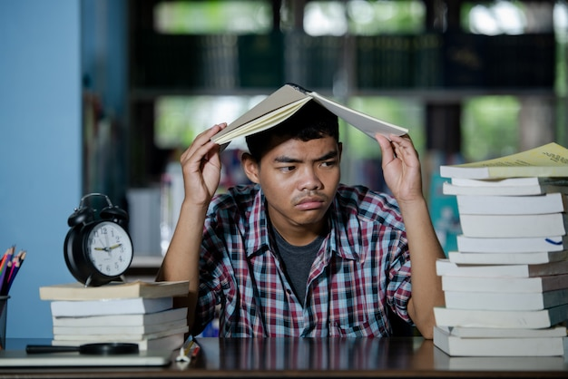 Educational conept: tired student in a library Free Photo