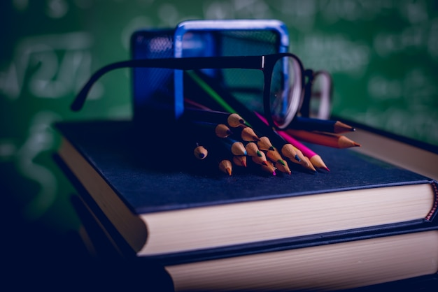 Educational equipment, boards and books education concept with copy space Premium Photo